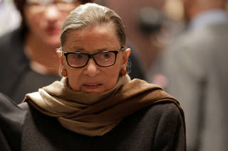 FILE PHOTO: File photo of U.S. Supreme Court Associate Justice Ruth Bader Ginsburg arriving to watch U.S. President Barack Obama's State of the Union address to a joint session of Congress in Washington