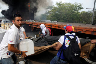 Truck that was carrying humanitarian aid for Venezuela is seen on fire in Cucuta