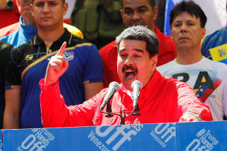 Venezuela's President Nicolas Maduro talks to supporters during a rally in support of the government in Caracas