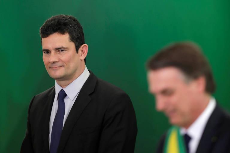 O ministro da Justiça, Sergio Moro, ao lado de Jair Bolsonaro durante a cerimônia de posse do presidente