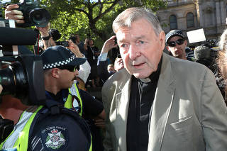 Cardinal George Pell arrives at County Court in Melbourne
