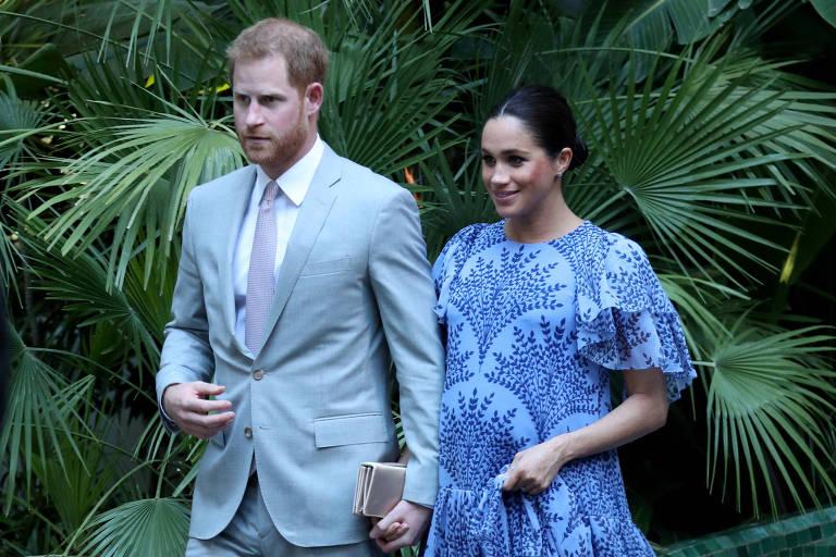 A duquesa de Sussex e o príncipe Harry durante viagem