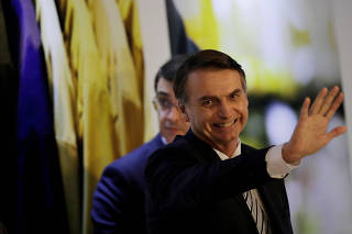 FILE PHOTO: Brazil's President Jair Bolsonaro waves at an inauguration ceremony of the new president of the Parliamentary Agricultural Front (FPA) in Brasilia