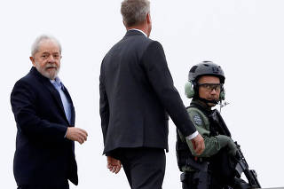 Brazil's former President Luiz Inacio Lula da Silva leaves the headquarters where he is serving a prison sentence to attend the funeral of his 7-year-old grandson, in Curitiba