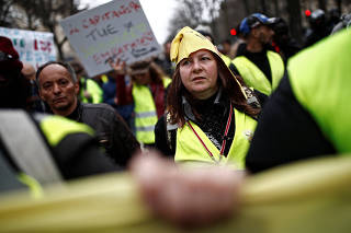Protesters wearing yellow vests are seen during a demonstration by the