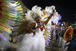 Reveller from Uniao da Ilha samba school performs during the second night of the Carnival parade at the Sambadrome in Rio de Janeiro
