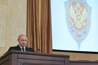 Russian President Vladimir Putin delivers a speech during a session of the Federal Security Service (FSB) board in Moscow