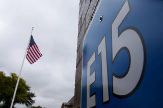 FILE PHOTO: A sign advertising E15, a gasoline with 15 percent of ethanol, is seen at a gas station in Clive