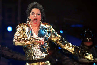 FILE PHOTO: American pop star Michael Jackson performs on stage during a concert at Moscow's Dinamo stadium.