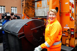 German Minister for Family affairs, Senior Citizens, Women and Youth, Franziska Giffey clears a garbage container in Berlin