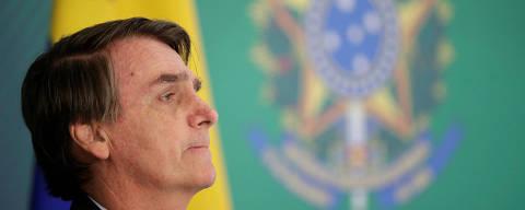 Brazil's President Jair Bolsonaro reacts during a press statement near Venezuelan opposition leader Juan Guaido after a meeting in Brasilia, Brazil February 28, 2019. REUTERS/Ueslei Marcelino ORG XMIT: UMS12