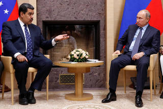 FILE PHOTO: Russian President Putin meets with his Venezuelan counterpart Maduro outside Moscow