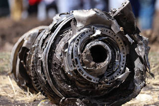 Airplane engine parts are seen at the scene of the Ethiopian Airlines Flight ET 302 plane crash, near the town of Bishoftu