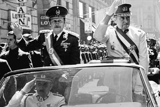 FILE PHOTO OF DICTATORS STROESSNER AND PINOCHET RIDING THROUGH SANTIAGO