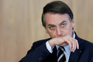 FILE PHOTO: Brazil's President Jair Bolsonaro attends a credentials presentation ceremony for several new top diplomats at Planalto Palace in Brasilia