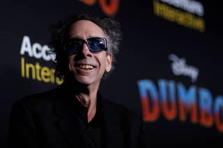 Director Tim Burton looks on at the premiere for the movie