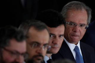 Brazil's Economy Minister Paulo Guedes reacts during a meeting between President Jair Bolsonaro and Paraguay's President Mario Abdo at the Planalto Palace in Brasilia