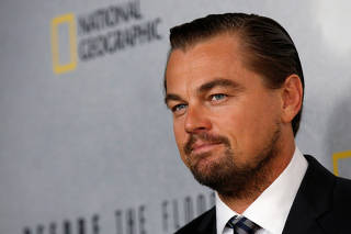 U.S. actor and UN Messenger of Peace Leonardo DiCaprio poses during arrivals for a screening of his documentary film