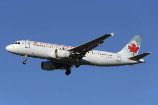An Air Canada airplane prepares to land at Vancouver's international airport in Richmond,