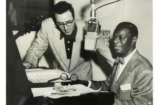 Pete Rugolo is pictured with singer Nat King Cole in this undated publicity photograph released to Reuters