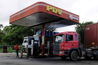 FILE PHOTO: The corporate logo of Venezuelan state-owned oil company PDVSA is seen at a gas station in Cupira