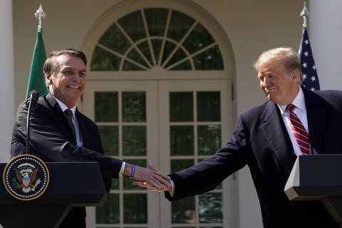 Brazil's President Jair Bolsonaro shakes hands with U.S. President Donald Trump at the conclusion of a joint news conference in the Rose Garden of the White House in Washington, U.S., March 19, 2019. REUTERS/Kevin Lamarque ORG XMIT: WAS475R