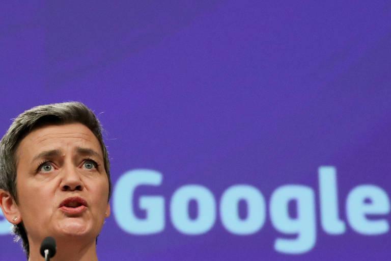 Rosto de Margrethe Vestager, com fundo escrito Google