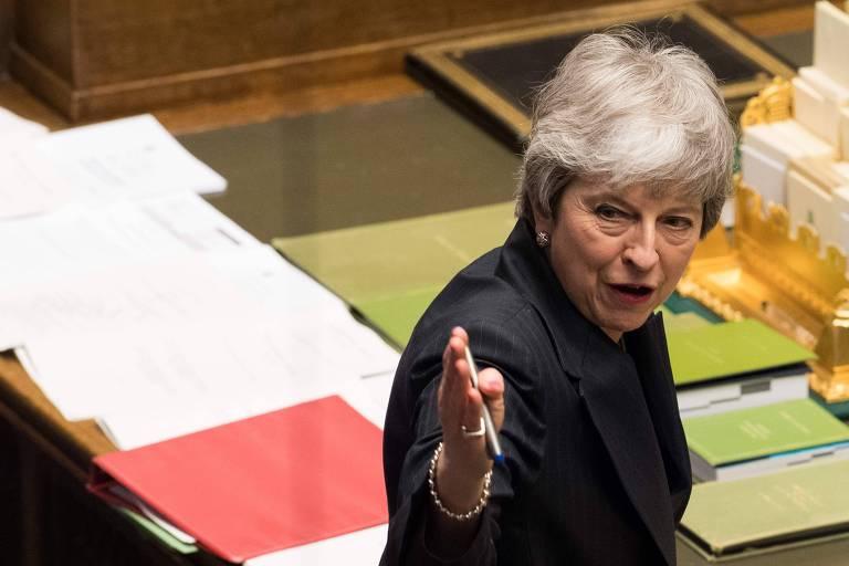 A primeira-ministra Theresa May durante os debates no Parlamento britânico nesta quarta (20)