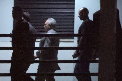 Brazil's former President Michel Temer (3rd L) is seen at the Federal Police headquarters in Rio de Janeiro, Brazil March 21, 2019 REUTERS/Ricardo Moraes ORG XMIT: BRA102