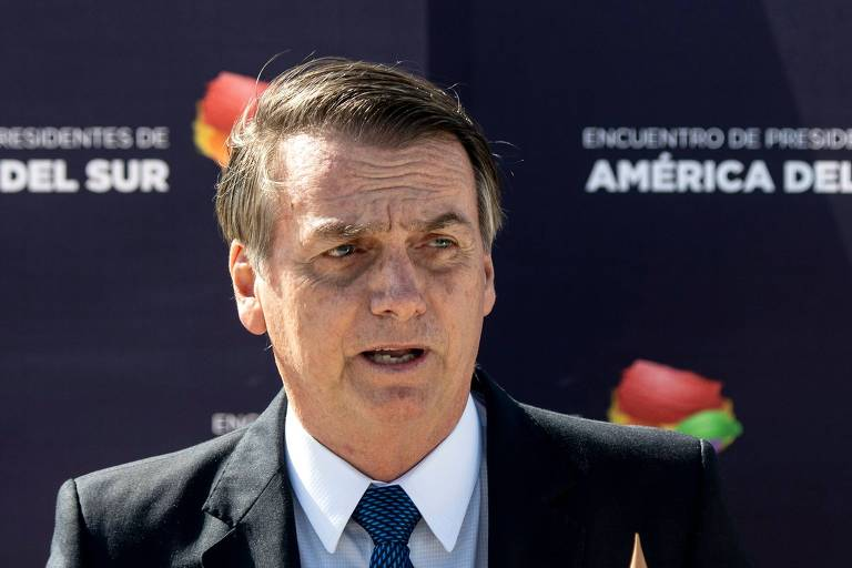 Presidente Jair Bolsonaro discursa após sua chegada a Santiago, no Chile, para sua primeira visita oficial ao país