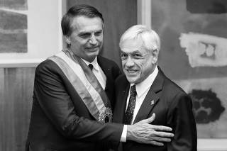 Brazil's President Jair Bolsonaro embraces his counterpart of Chile, Sebastian Pinera, in Brasilia