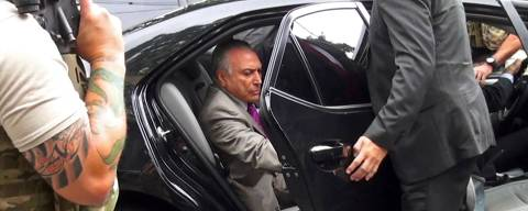 Video grab showing former Brazil's president (2016-2018) Michel Temer (R), getting on a vehicle after being arrested on 'Car Wash' probe, on March 21, 2019 , in Sao Paulo metropolitan area in Brazil. - Brazil's ex-president Michel Temer was the leader of a