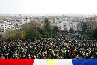 Protesters wearing yellow vests attend a demonstration in front of the Sacre-Coeur Basilica of Montmartre during the Act XIX (the 19th consecutive national protest on Saturday) of the