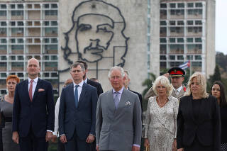 Britain's Prince Charles and Camilla, Duchess of Cornwall, stand near an image of late revolutionary hero Ernesto