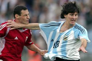 Messi of Argentina challenges Vanczak of Hungary during their friendly soccer match in Budapest