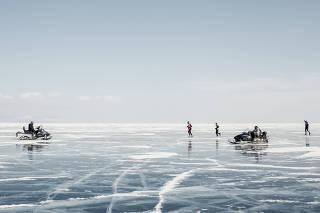 Baikal Ice Marathon participants run on the frozen surface of Lake Baikal, in Russia.