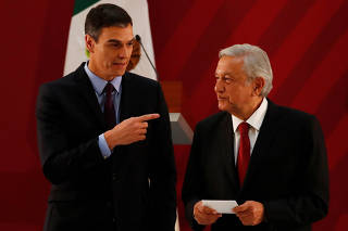 Spain's Prime Minister Pedro Sanchez and Mexico's President Andres Manuel Lopez Obrador gesture after giving their statement to the media after a meeting at Palacio Nacional in Mexico City