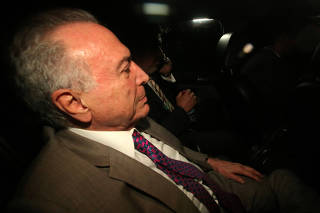 Brazil's former President Michel Temer arrives at his home in Sao Paulo