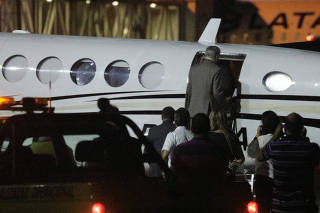 Brazil's former President Michel Temer enters in an airplane at Santos Dumont airport in Rio de Janeiro