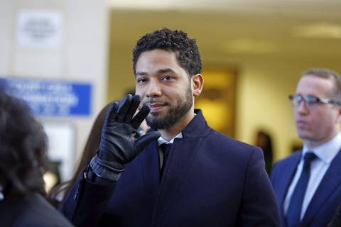 CHICAGO, ILLINOIS - MARCH 26: Actor Jussie Smollett waves as he follows his attorney to the microphones after his court appearance at Leighton Courthouse on March 26, 2019 in Chicago, Illinois. This morning in court it was announced that all charges were dropped against the actor.   Nuccio DiNuzzo/Getty Images/AFP == FOR NEWSPAPERS, INTERNET, TELCOS & TELEVISION USE ONLY ==