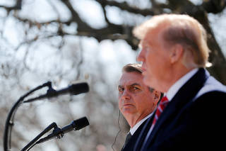 FILE PHOTO: U.S. President Trump and Brazilian President Bolsonaro hold news conference at the White House in Washington