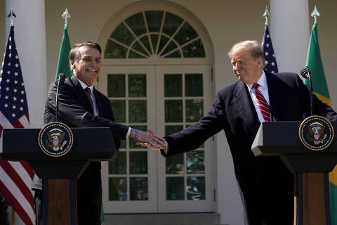 FILE PHOTO: Brazil's President Jair Bolsonaro shakes hands with U.S. President Donald Trump at the conclusion of a joint news conference in the Rose Garden of the White House in Washington, U.S., March 19, 2019. REUTERS/Kevin Lamarque/File Photo ORG XMIT: FW1