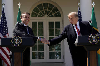FILE PHOTO: U.S. President Donald Trump and Brazil's President Jair Bolsonaro hold a joint news conference at the White House in Washington