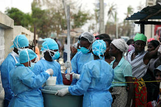 FILE PHOTO: Medical staff mix a chlorine solution for distribution at a health centre dealing with water borne diseases in Beira