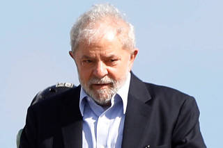 Brazil's former President Luiz Inacio Lula da Silva arrives at the headquarters where he is serving a prison sentence, after attending the funeral of his 7-year-old grandson, in Curitiba