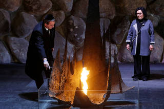 Brazilian President Jair Bolsonaro rekindles the eternal flame at a ceremony commemorating the six million Jews killed by the Nazis during the Holocaust, at Yad Vashem World Holocaust Remembrance Center in Jerusalem