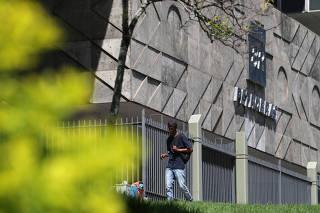 Man walks next to Brazil's state-run Petrobras oil company headquarters in Rio de Janeiro