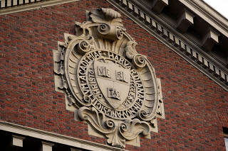 FILE PHOTO: A seal hangs over a building at Harvard University in Cambridge