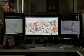 'Il Paesaggio' by Renaissance artist Leonardo da Vinci is seen on computer monitors during tests at the Opificio delle Pietre Dure di Firenze in Florence