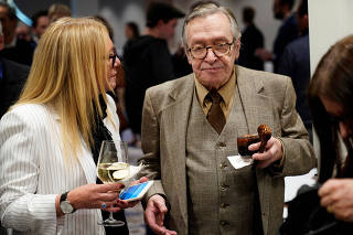 Brazilian writer Olavo de Carvalho arrives for the showing of a documentary on the government of Brazilian President Jair Bolsonaro in Washington